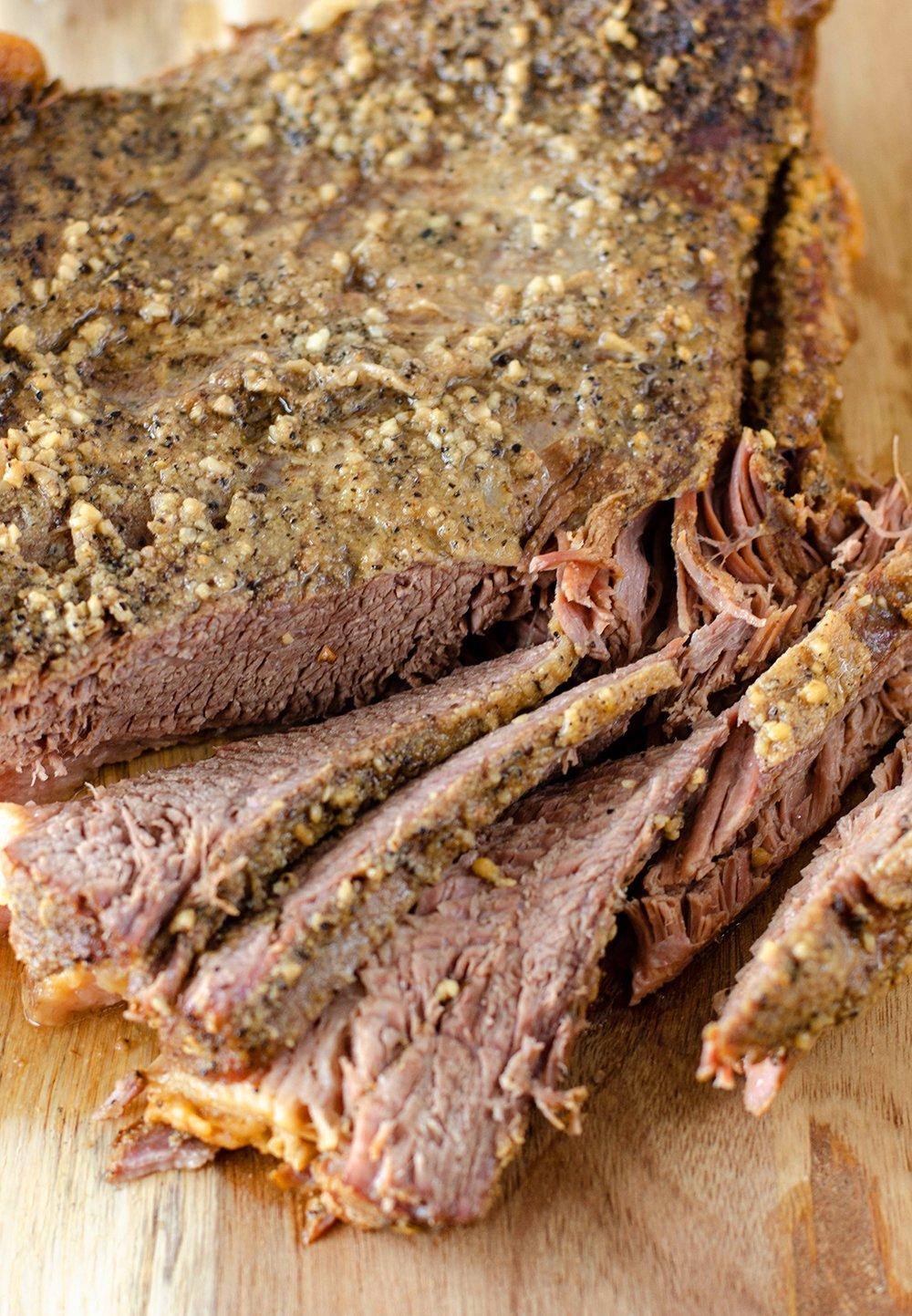 Beef Brisket on a cutting board, sliced.