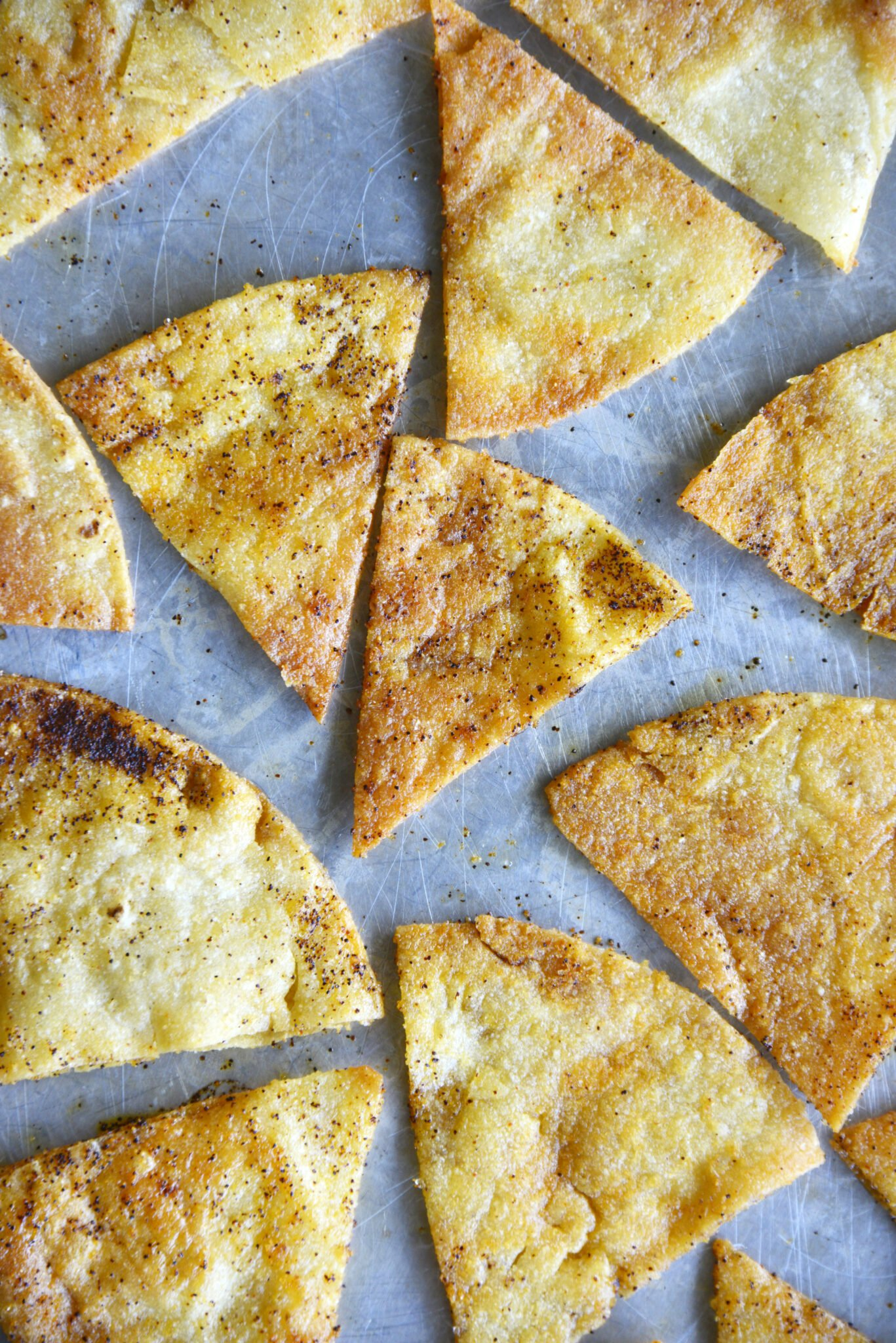 a sheet pan of baked tortilla chips