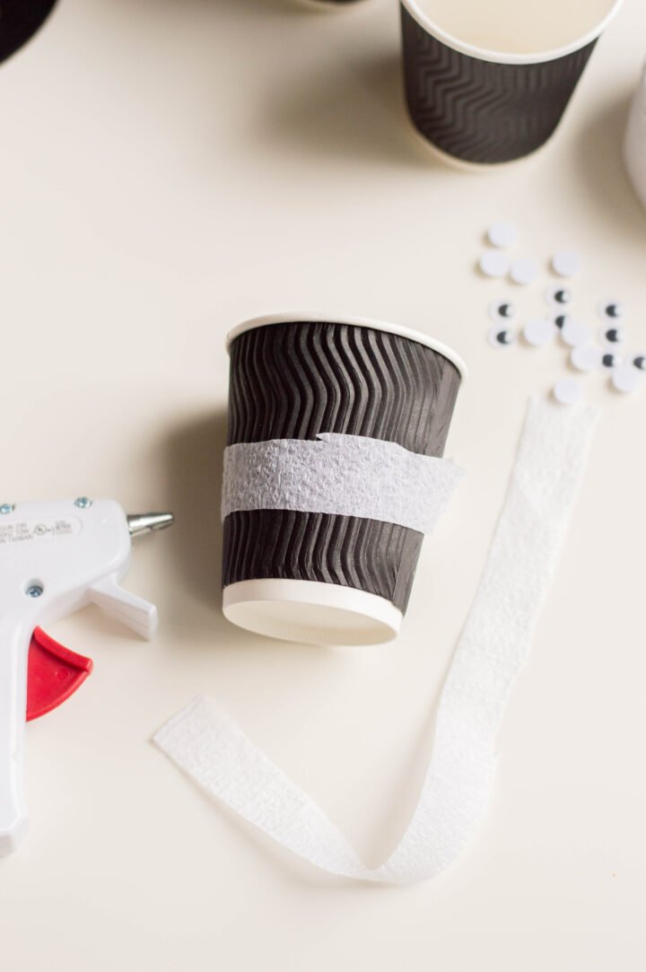 Halloween treat cup step 1: wrap with white streamers