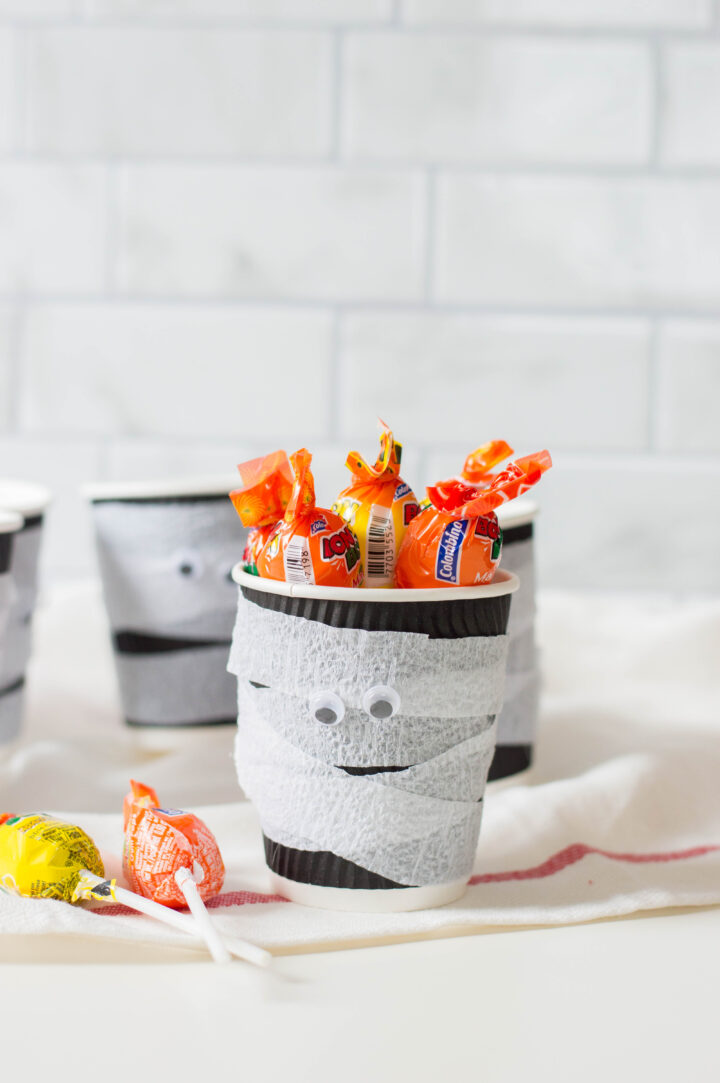 Fill your Halloween treat cups with candy!