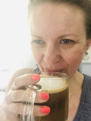 Janel from NellieBellie holding a mug of coffee