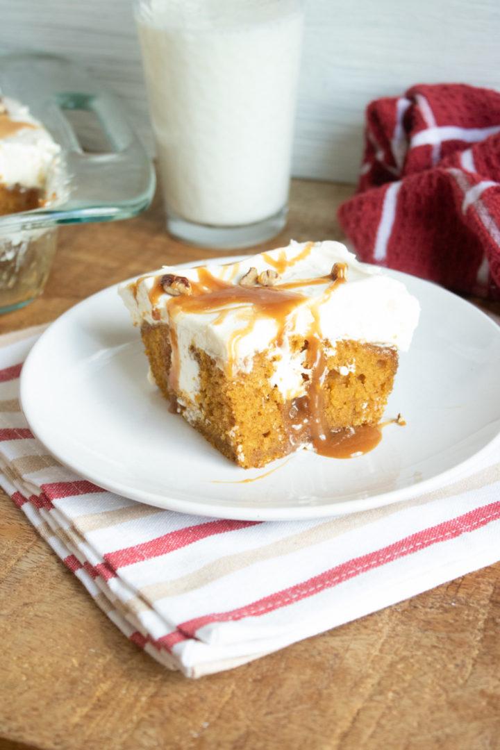 Pumpkin Poke Cake with cream cheese and caramel