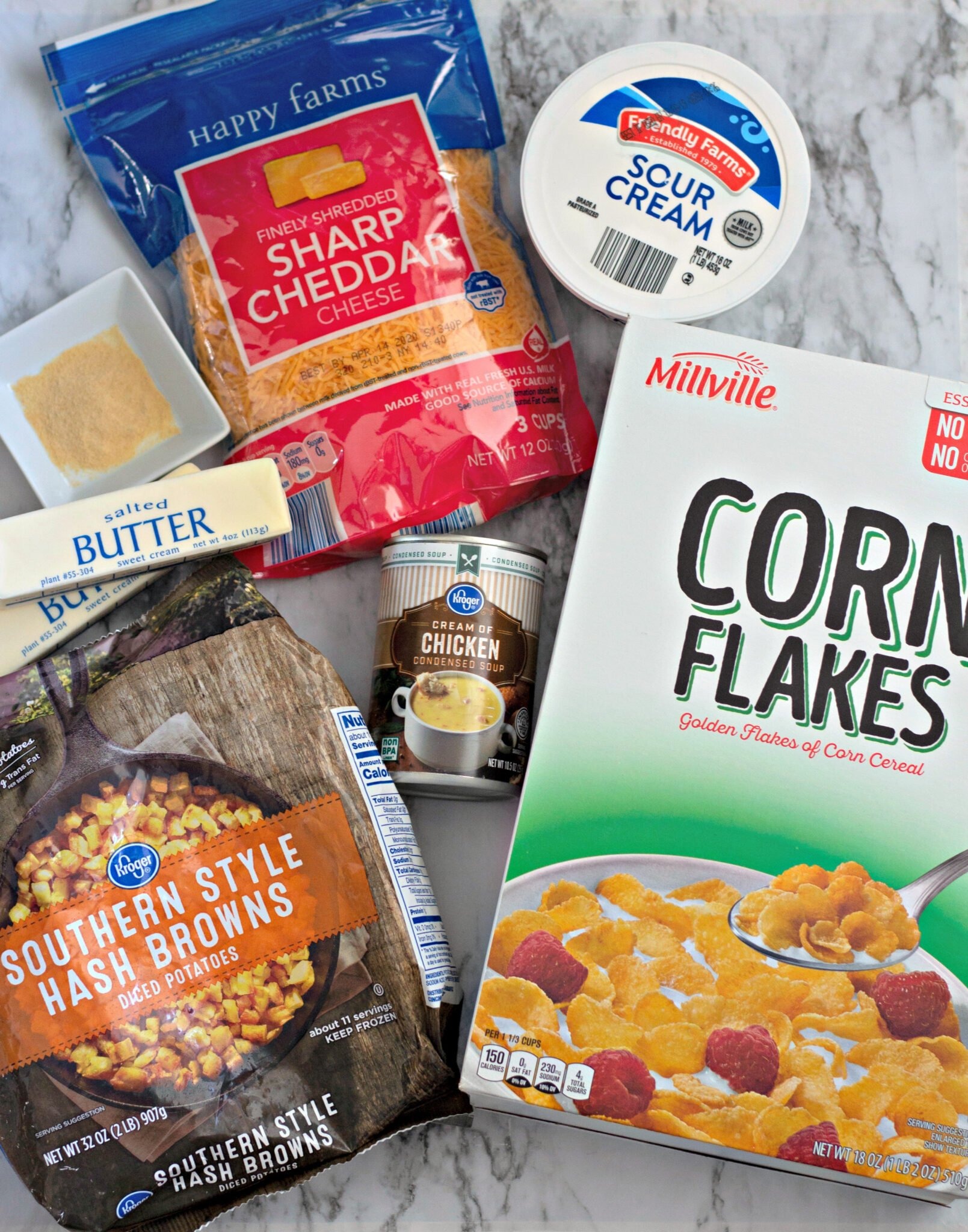 Needed ingredients for funeral potatoes include diced frozen potatoes, cheese, cornflakes, butter, and cream of chicken soup.