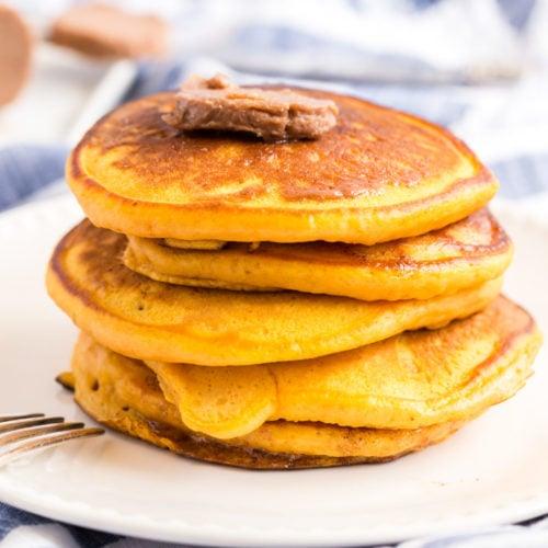 Stack of buttermilk pumpkin pancakes with cinnamon butter