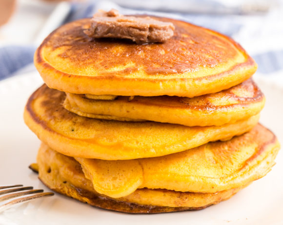 Stack of buttermilk pumpkin pancakes with cinnamon butter