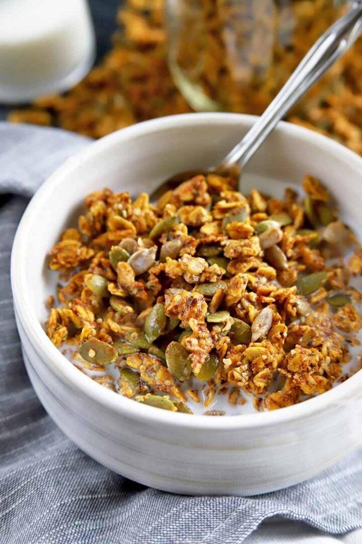 Bowl of pumpkin spice granola with pumpkin seeds.
