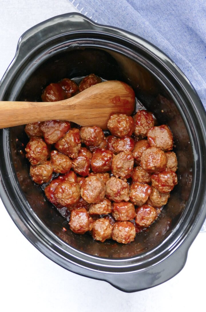 Crockpot full of sweet and spicy meatballs ready to be spooned up.