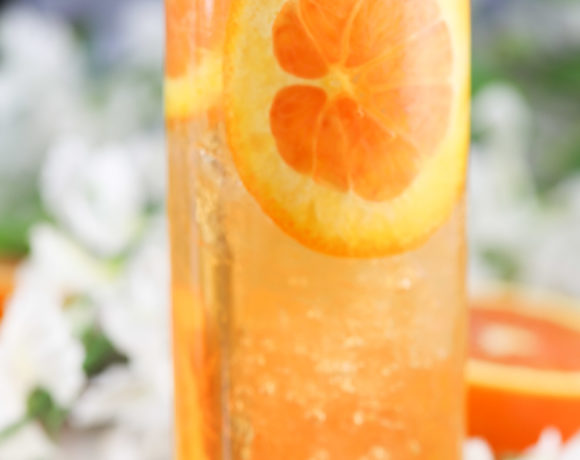 fresh orange slices and mint in an orange cocktail