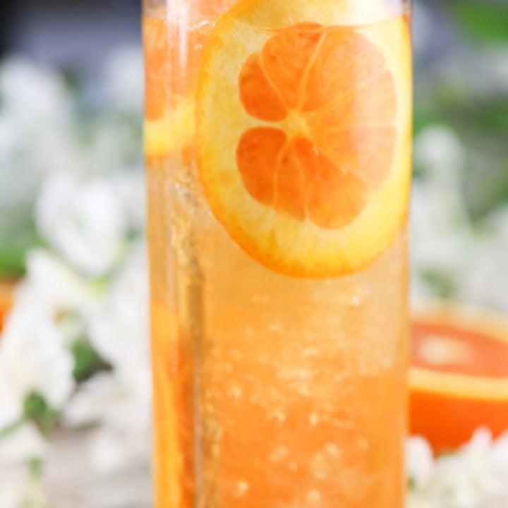 fresh orange slices and mint in an orange cocktail