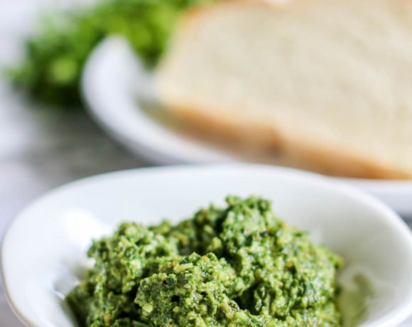 A bright green pesto that uses fresh basil and walnuts in the ingredients.