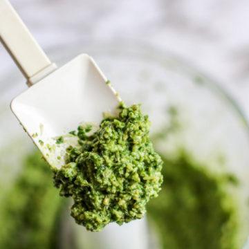 a spatula of fresh basil pesto