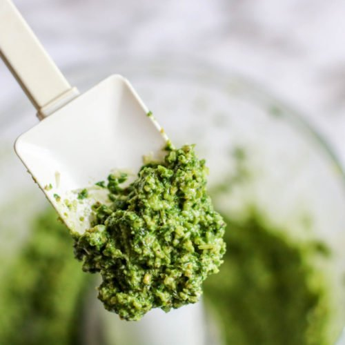 a spatula of fresh basil pesto