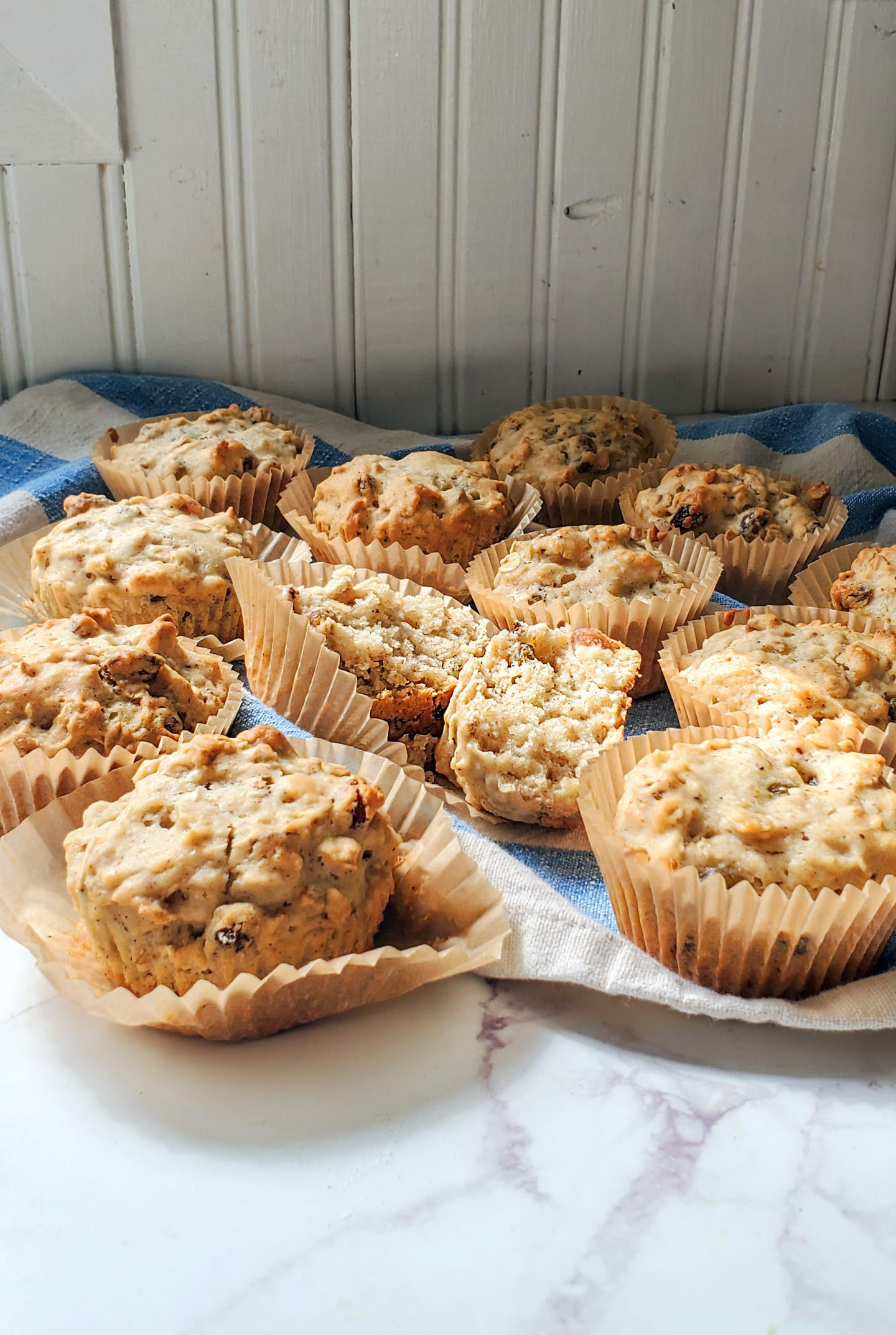 A counter full of applesauce muffins
