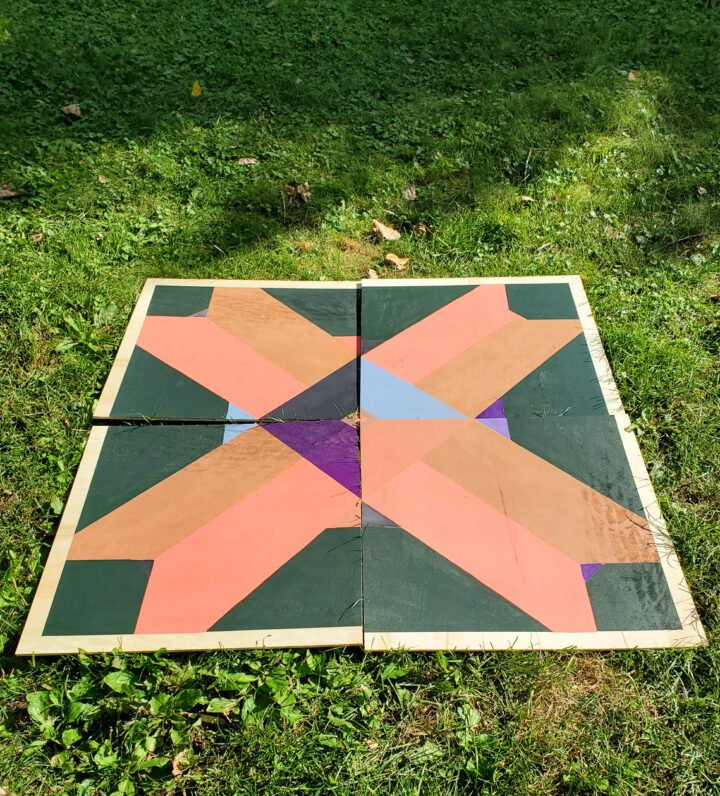 All of the squares of the diy barn quilt laid out together.