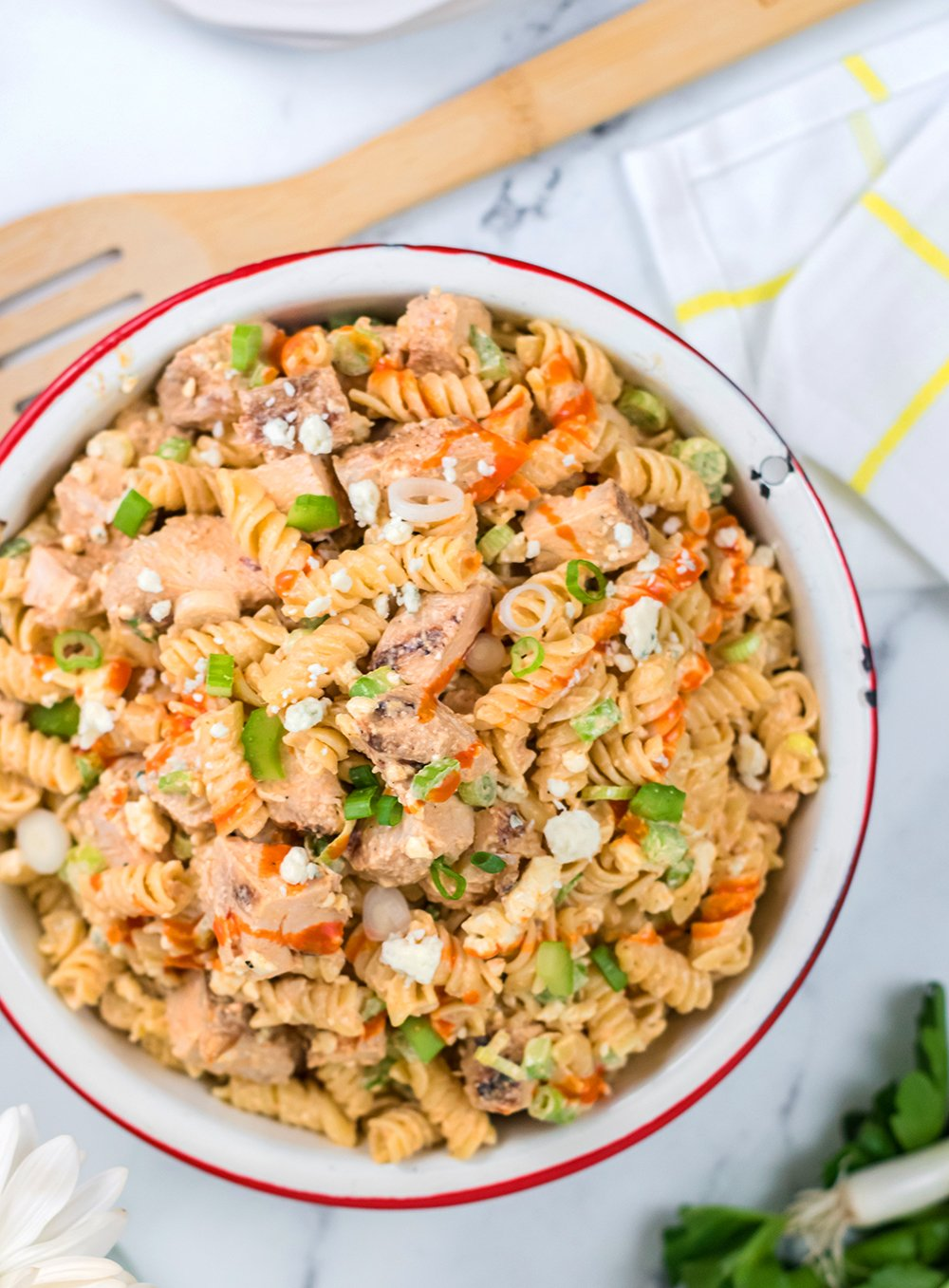 A creamy buffalo dressing mixed with pasta, chicken, and blue cheese.