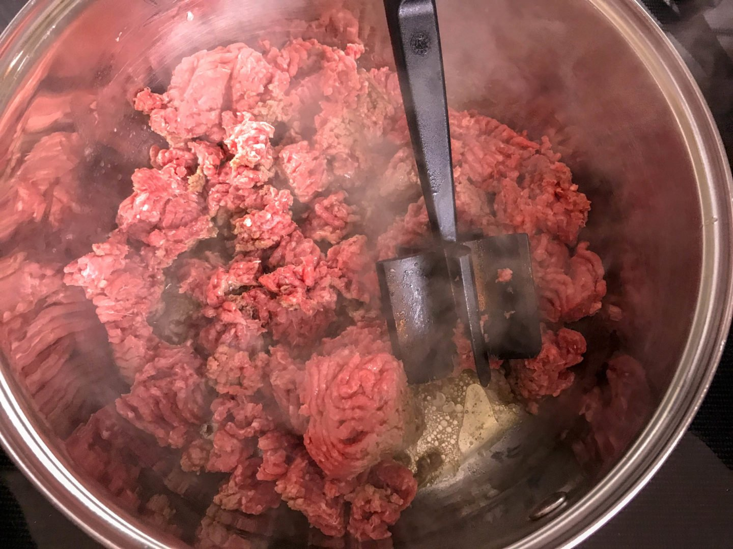 ground beef browning in a pan