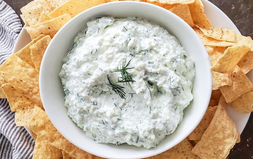A bowl of Greek Yogurt, Cucumber, and fresh dill made into a yummy dip