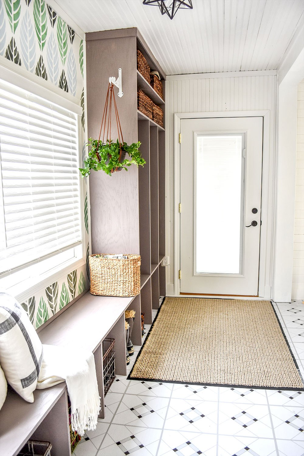 A long hallway turns into a beautiful entry with custom cubbies.