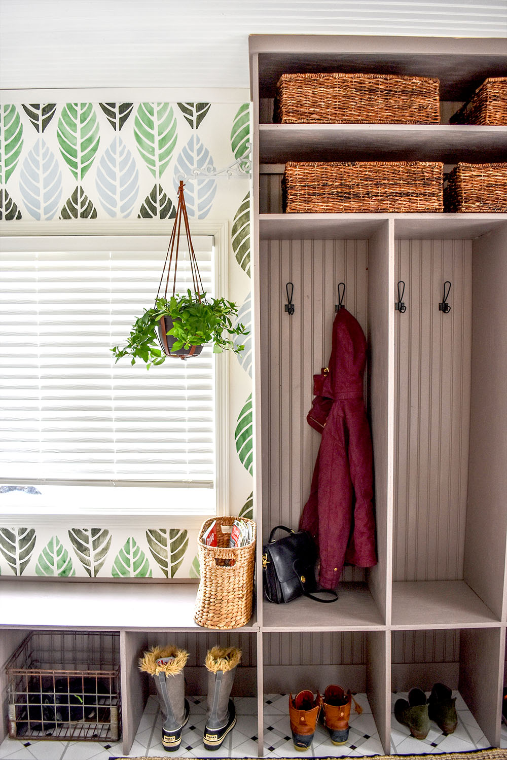 A gorgeous updated entry with DIY cubbies, stenciled wall, and many more beautiful details.