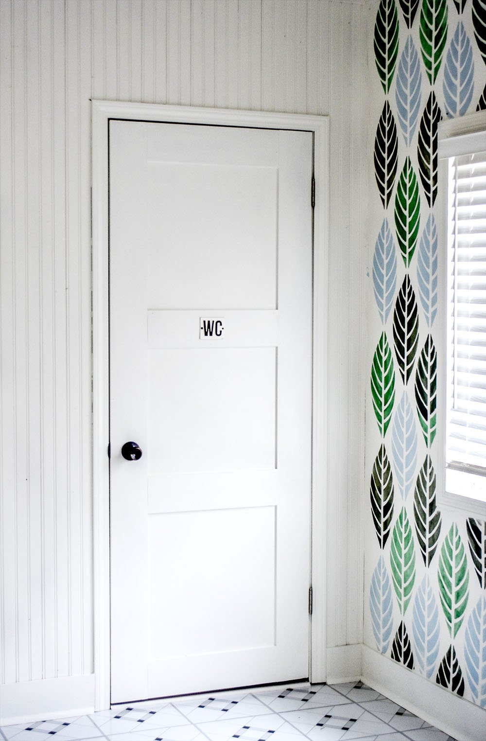 Turn a hollow door into a beautiful door with simple boards and paint.