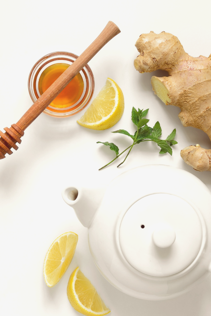 A tea pot, fresh ginger root, honey, and lemon are what you need to make homemade ginger root tea.