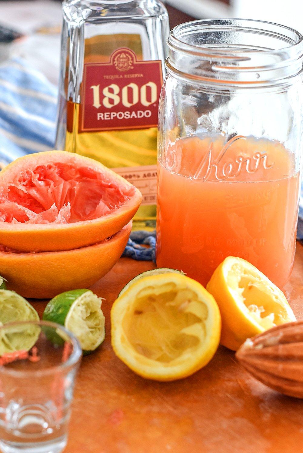 Gold tequila, grapefruit, limes, and lemons for margaritas