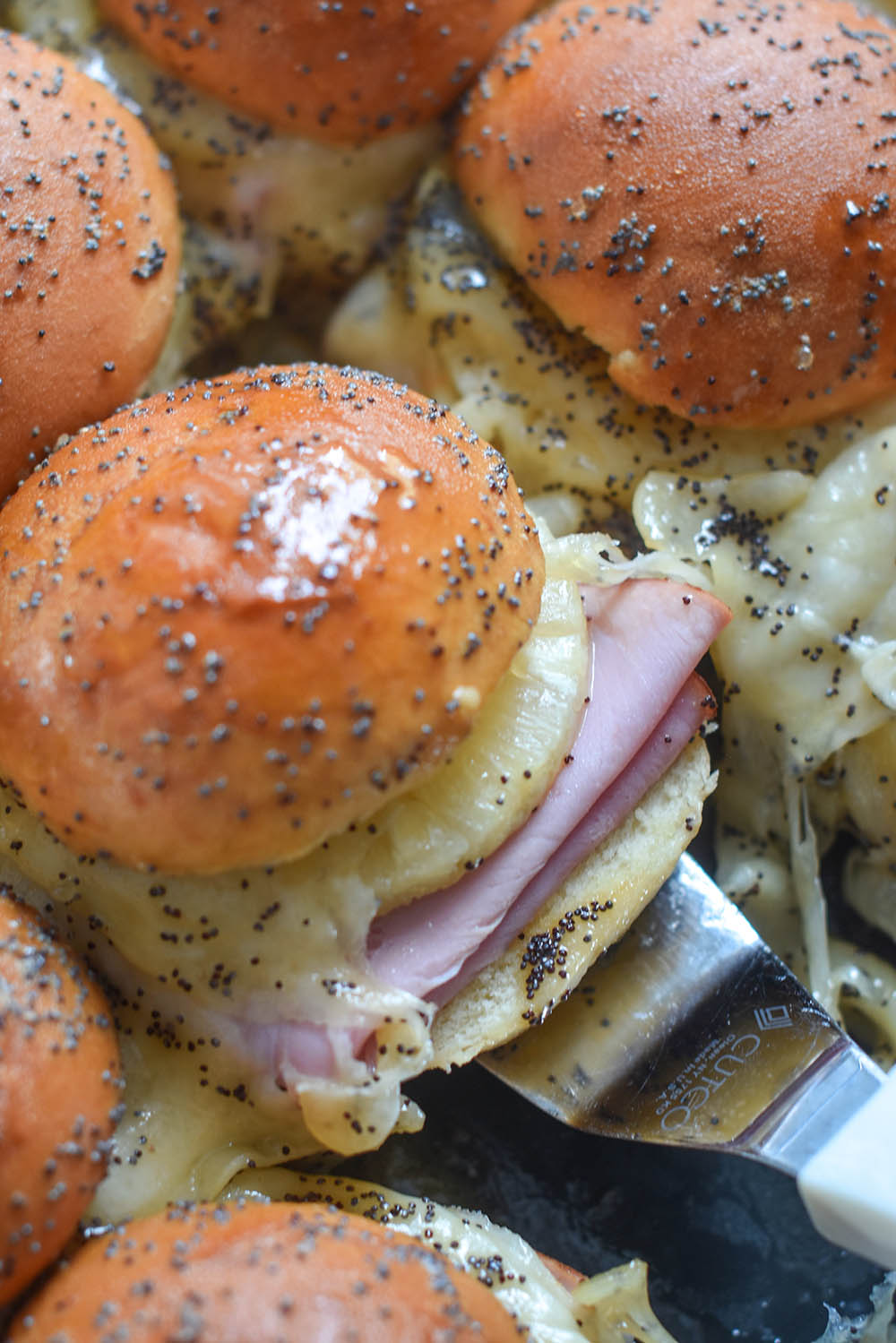 A Ham and Cheese Slider with pineapple and poppyseeds