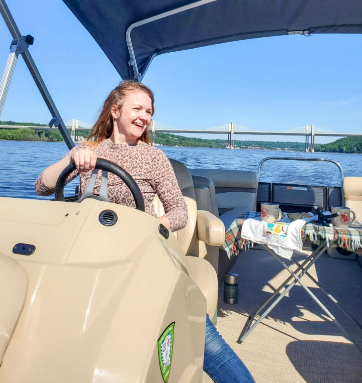 Janel driving a pontoon from Stillwater Boat rental on the St. Croix River