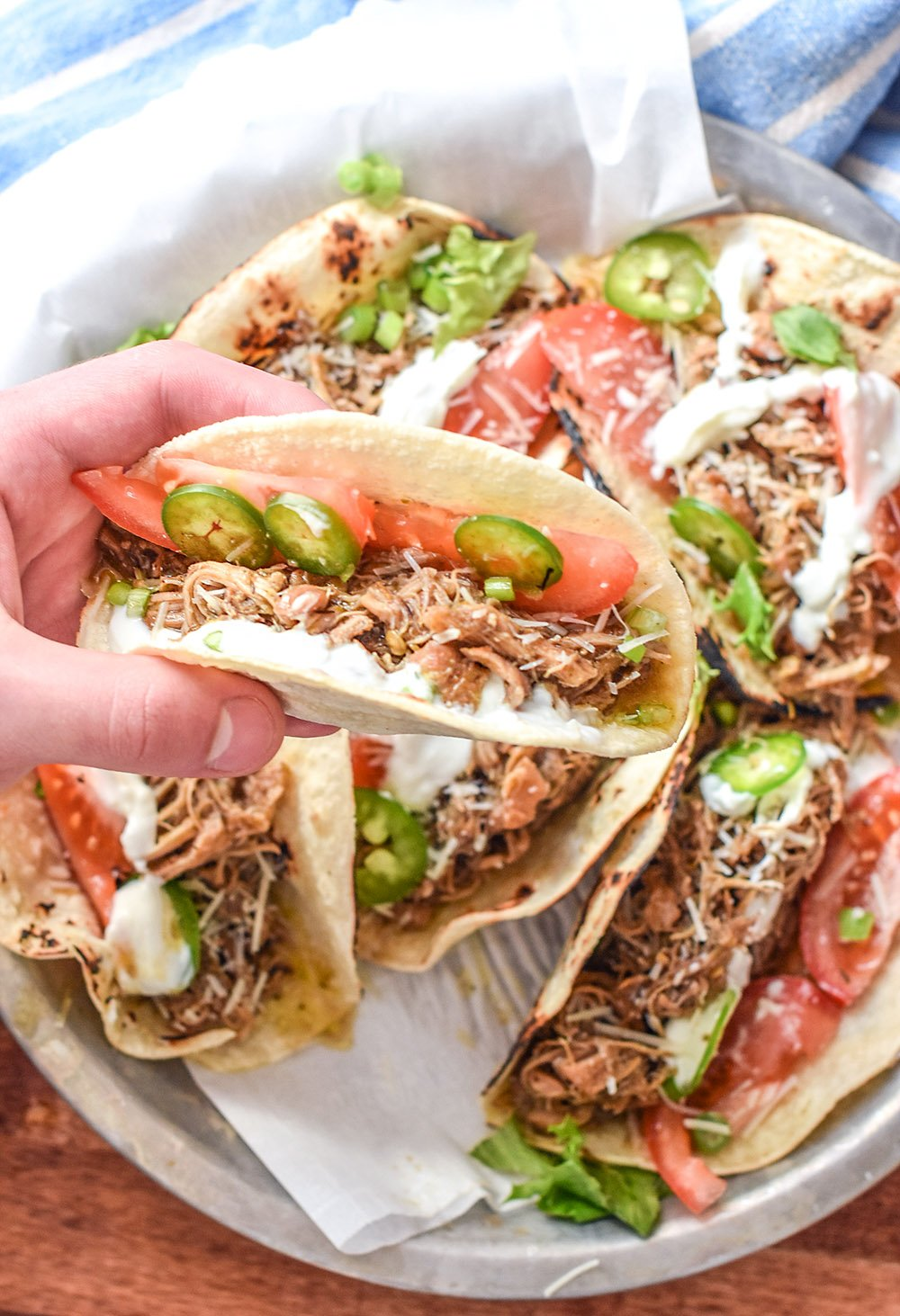 a taco with shredded jerk chicken