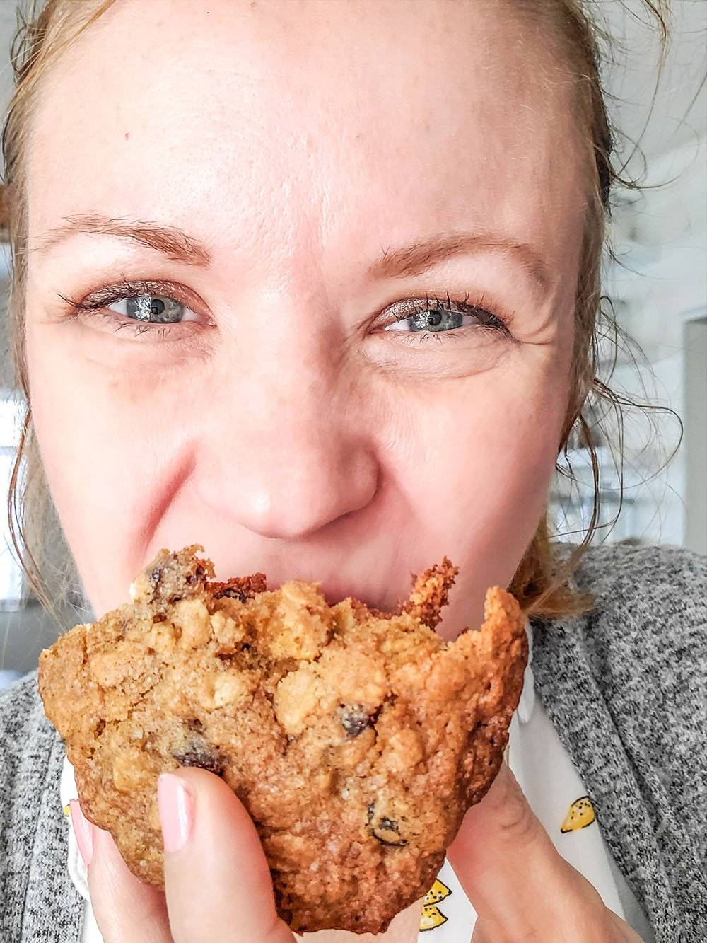 the BEST Oatmeal Raisin Cookie being held by Janel Hutton from NellieBEllie