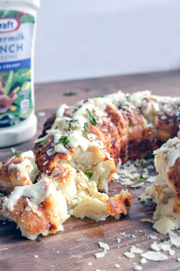 Cheesy pull apart bread made with biscuits and a bottle of ranch dressing.
