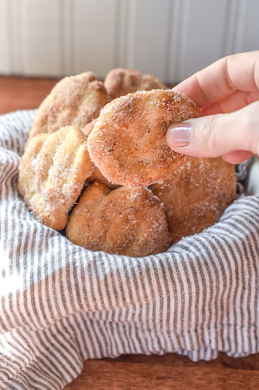 Bread dough fried in the air fryer and coated with cinnamon and sugar.