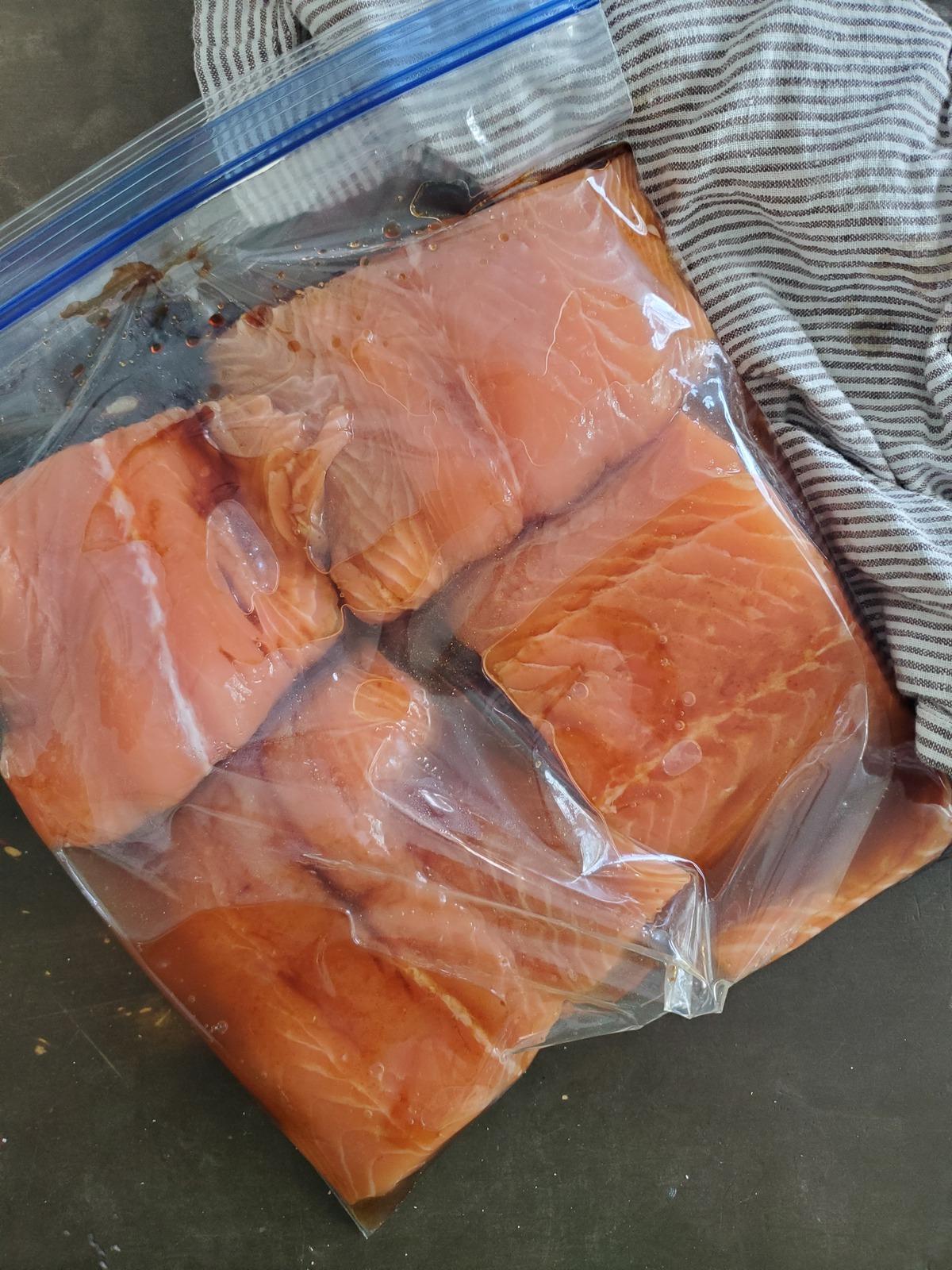 A ziplock bag of salmon marinating