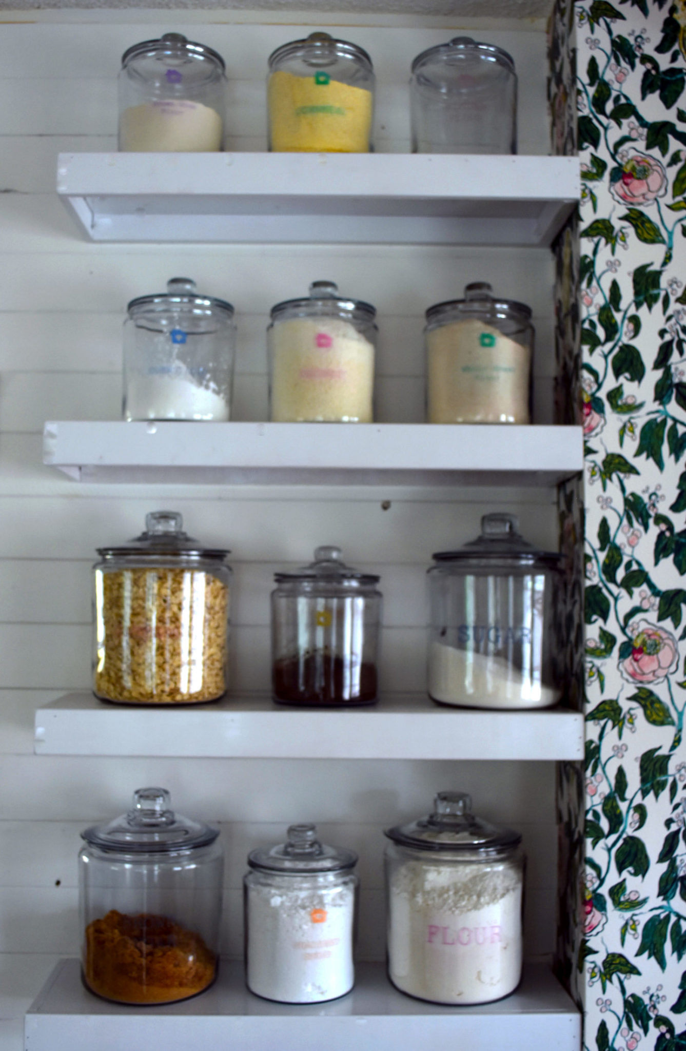 a shelf of glass jar for pantry