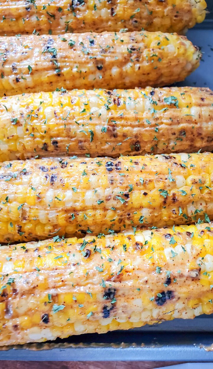Grilled corn on the cob smothered with a mayo and paprika mixture.