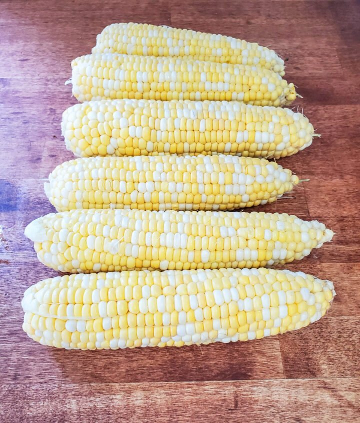 Sweet corn shucked and ready to grill.