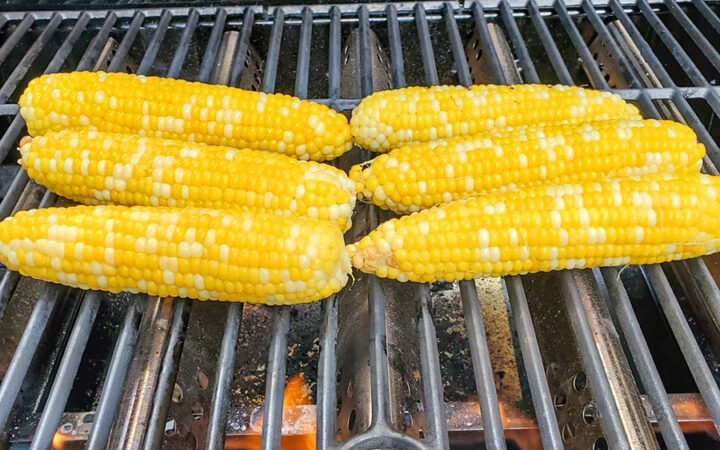 Sweet corn being grilled for Mexican Street Corn