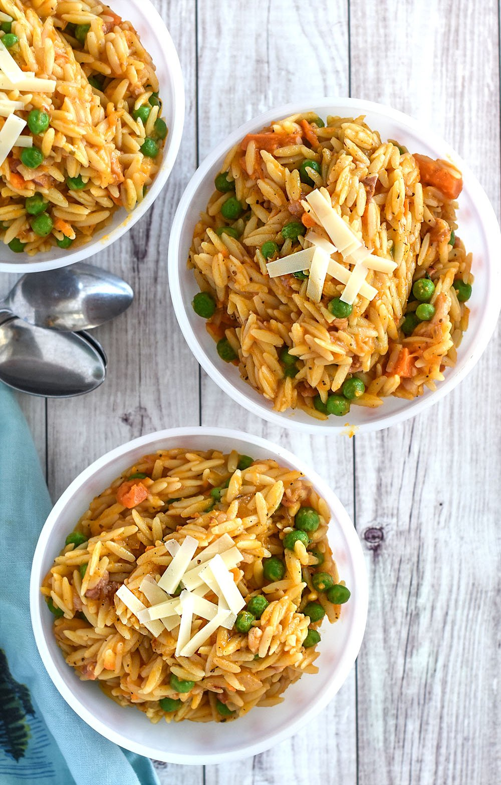 Bowls of sweet potato orzo with peas.