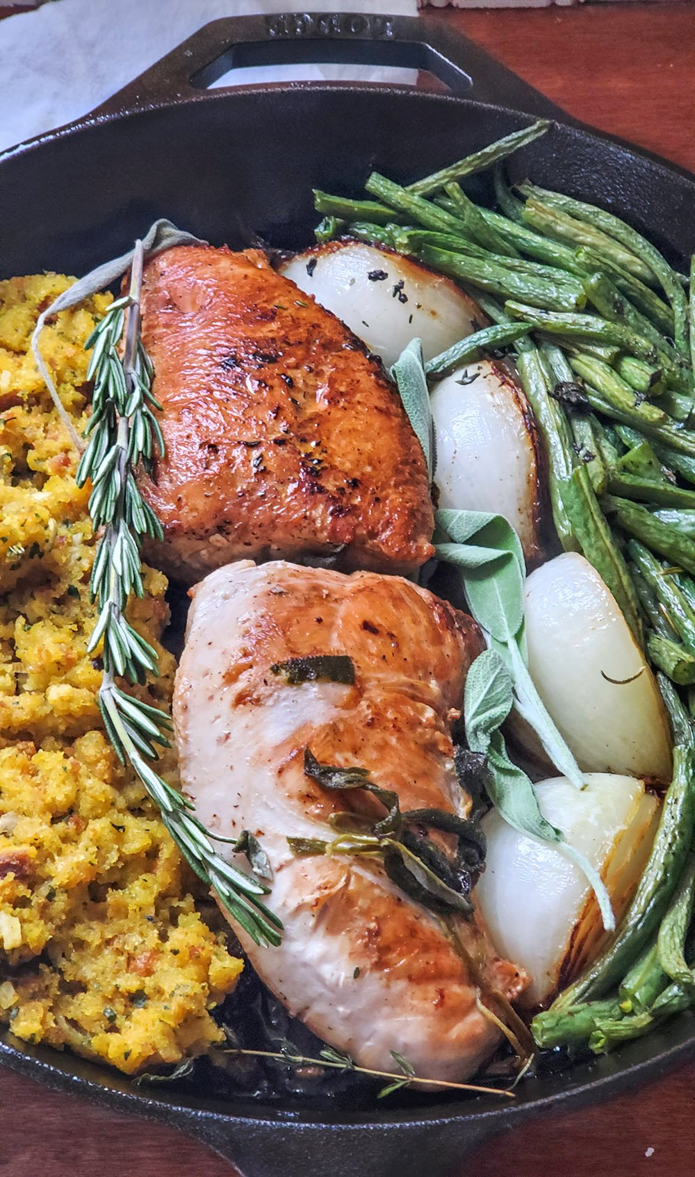 Turkey tenderloin sauteed on the stovetop and then baked in the oven along with veggies, stuffing, and fresh herbs.