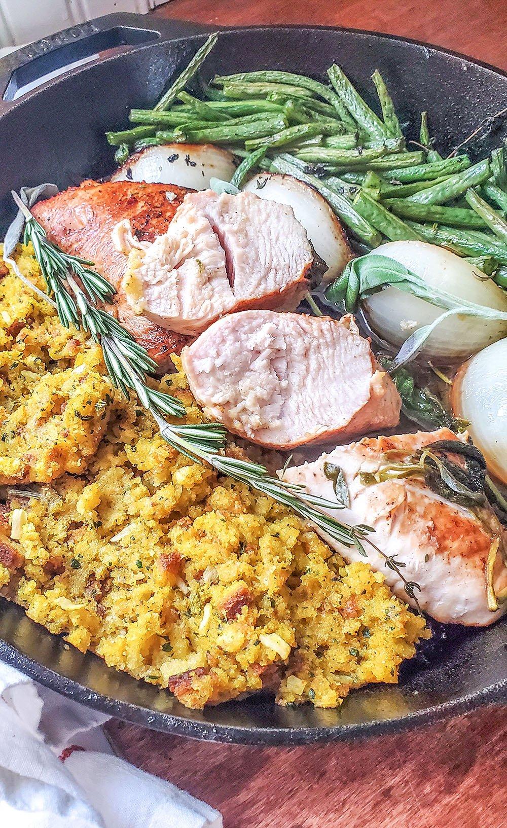 Turkey tenderloin dinner cooked up in a cast iron pan. Juicy turkey served along crispy green beans.